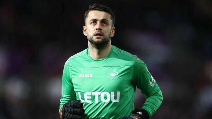 Thủ môn: LUKASZ FABIANSKI | SWANSEA CITY -Fabianski có tổng cộng 5 pha cứu thua, nhiều hơn bất kì thủ thành nào tại Ngoại hạng Anh ở vòng 13, và giúp Swansea có trận hoà không bàn thắng trước Bournemouth.