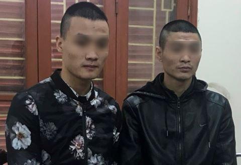 2 đối tượng Lê Ngọc Sơn và Cao Văn Quân tại cơ quan điều tra.