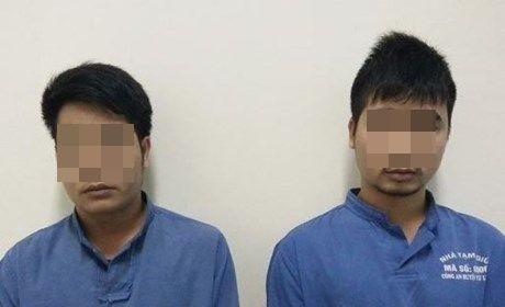 Hai đối tượng Nguyễn Phi Trung vàNguyễn Hạ Long tại cơ quan công an