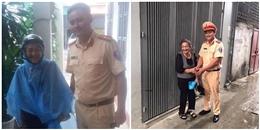 CSGT Hà Nội giúpcụ già bị lạc đường ngã sõng soài trong mưa