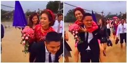 Đám cưới HOT ngày bão: Chú rể lội nước, hạnh phúc cõng cô dâu gây 'sốt' mạng