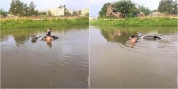 Mải xem điện thoại, cô gái phi thẳng ô tô xuống giữa dòng sông