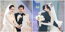 Hoa hậu Đặng Thu Thảo ôm chặt chồng đại gia trong tiệc cưới