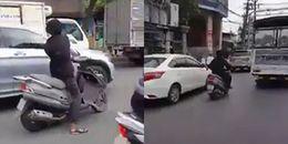 Truy bắt đối tượng cầm mã tấu chém hàng loạt gương ô tô trên đường phố Sài Gòn