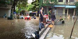 Chùm ảnh: Mưa lũ khiến nhiều tỉnh thành ngập sâu trong biển nước