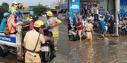 Ấm áp ngày mưa Sài Gòn: CSGT xông xáo lội nước, dùng xe chuyên dụng chở người dân qua vùng ngập