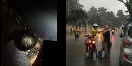 Cầm ô che suốt 45 phút cho tài xế hì hục thay lốp giữa trời mưa, chàng trai nhận nhiều lời khen
