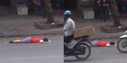 Clip bé trai nằm giữa đường Hà Nội, người lớn trông thấy nhưng lại vô tâm bước qua gây tranh cãi MXH