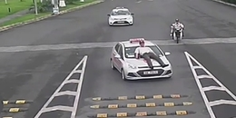 Lái xe taxi húc thẳng nhân viên sân bay Nội Bài lên nóc capo, do bị ngăn cản đón khách sai quy định