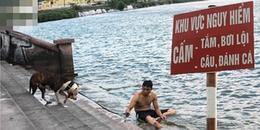 Mặc biển báo, người dân Thủ đô vẫn dắt thú cưng ra Hồ Tây tắm mát, giải nhiệt những ngày đầu hè