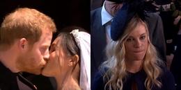 Biểu cảm lạ lùng của bạn gái cũ khi hoàng tử Harry hôn Meghan trong đám cưới