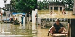 Sau gần 1 tuần ngập lụt, người dân Hà Nội vẫn 'bơi' trong biển nước, chèo thuyền giữa đường