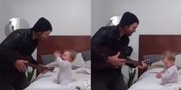 Đoạn clip ông bố cực ngầu vừa đánh đàn vừa hát cho cô con gái nghe thu hút hơn 100 triệu lượt xem