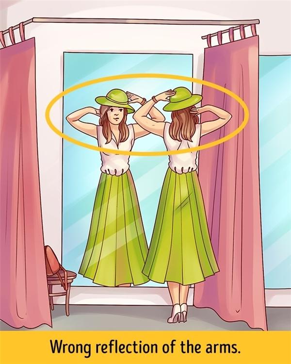 Vị trí cánh tay ảnh trong gương của cô gái bị sai vị trí.