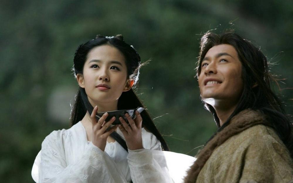 """Huỳnh Hiểu Minh vào vai Dương Quá trong """"Thần Điêu Đại Hiệp""""cùng với Lưu Diệc Phi trong vai Tiểu Long Nữ"""