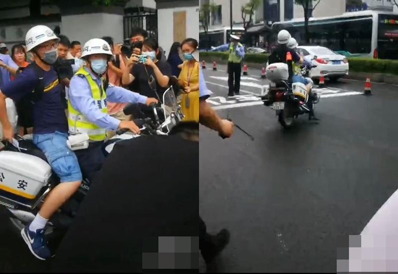 Thí sinh được cảnh sát hỗ trợ chở thẳng đến điểm thi vì trễ giờ. (Ảnh: Cắt từ clip).