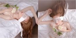 Elly Trần gây tranh cãi khi táo bạo diện trang phục mỏng tang, bịt mắt trên giường